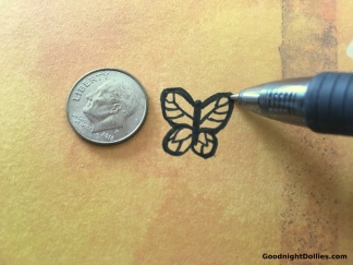 Draw a butterfly about the size of a dime.