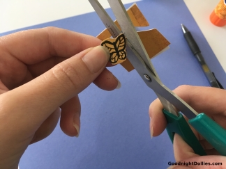 Carefully trim around the butterfly.