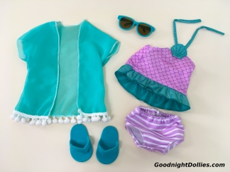 Cover-up, sunglasses, flip flops, & two-peice swimsuit